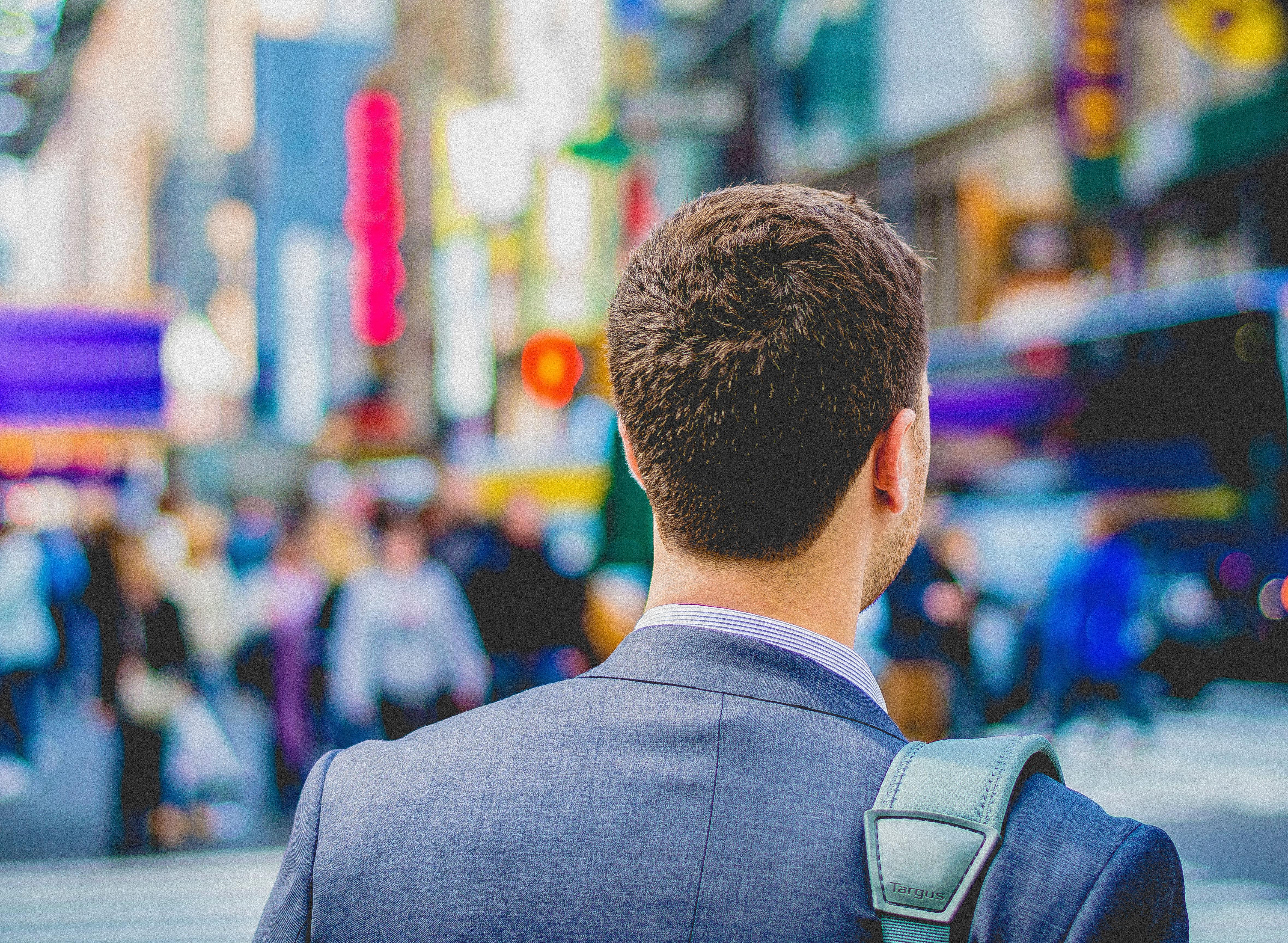 Businessman walking the streets with shoulder bag